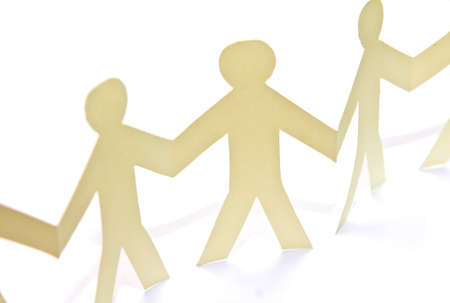 Cutout paper people over white background Stock Photo - 13629991