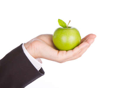 Businessman hand with a green apple in his hand isolate on white background photo