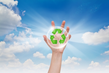 Eco concept : Business hand point recycling symbol photo