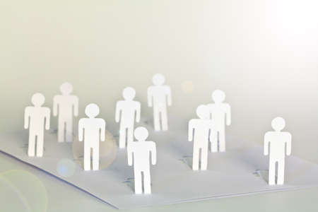 close up of people cut out of paper on table Stock Photo - 13625941