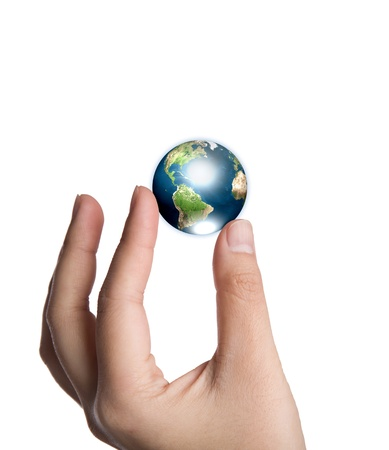 Earth in hand isolated on white background  (Elements of this image furnished by NASA) photo