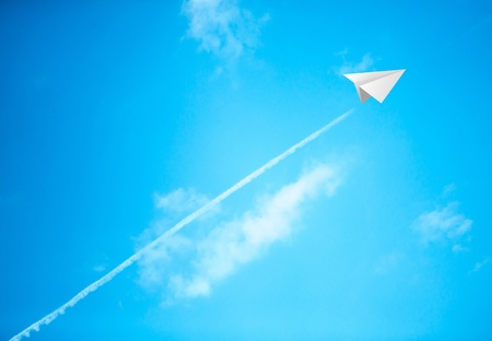 Paper planes in blue sky photo