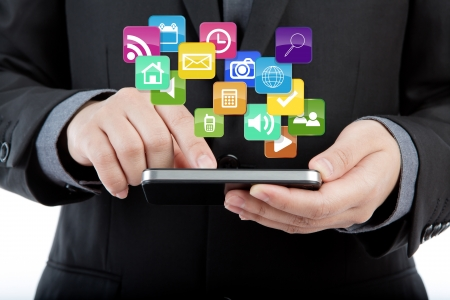 Business man use mobile phone with colorful application icons photo