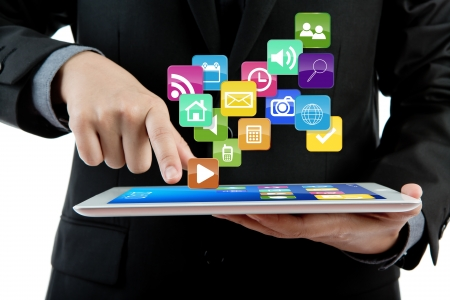 Business man use tablet pc computer with colorful application photo
