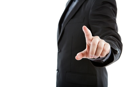 Business man touching an imaginary screen against white background photo