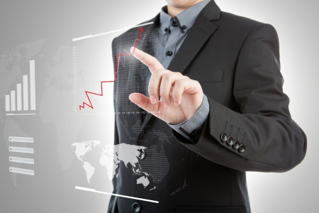 Business man pressing high tech type of modern graph on a virtual background photo