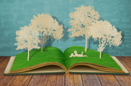 Paper cut of children read a book under tree on old book Stock Photo - 13783531