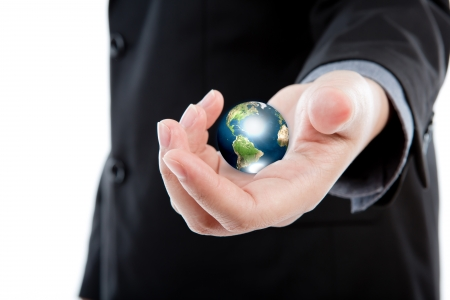 Business man holding the  small world in his hands against white background  (Elements of this image furnished by NASA) photo