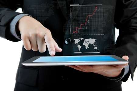 Business man holding the modern digital tablet pc with success growth chart Stock Photo - 13850794