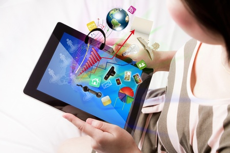 Woman reading the touch screen device (Elements of this image furnished by NASA) Stock Photo - 13986923