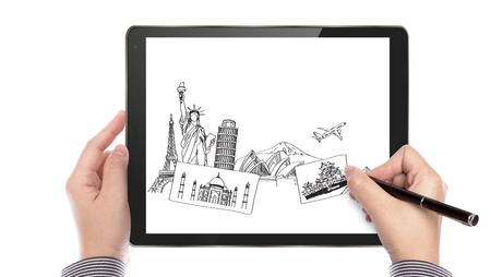 Business man write travel plan on touch screen device photo