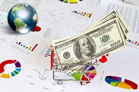 Dollar and business graph with earth (Elements of this image furnished by NASA) photo