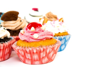 Cupcakes isolated on white background photo