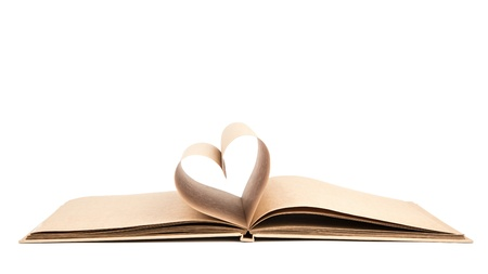 Book with opened pages of shape of heart isolated on white background Stock Photo