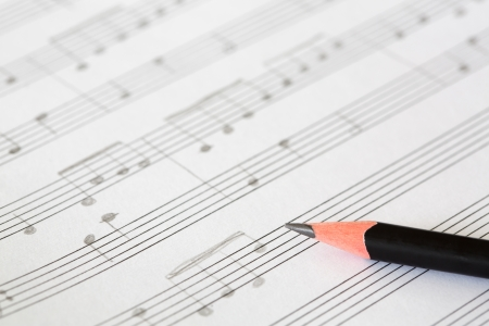Pencil and music sheet photo
