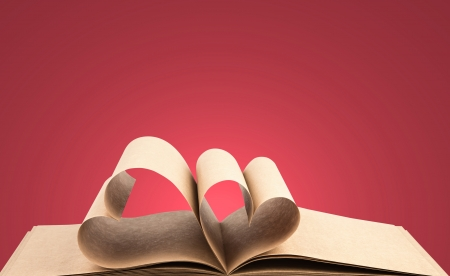 Book with opened pages of shape of heart photo