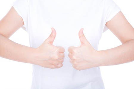 Two women hands showing thumbs up sign against white background photo