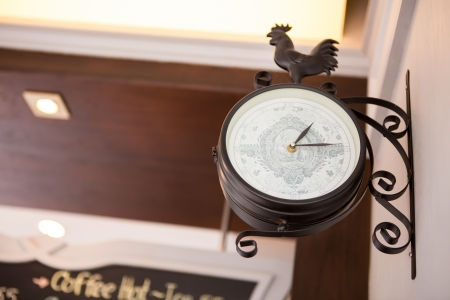 Old style hanging clock photo