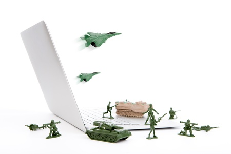 Computer security concept :  soldiers,tank,plane  are guarding a laptop from viruses, spyware and hacker Stock Photo - 14850648