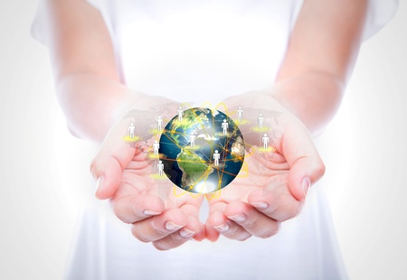 environmental responsibility: Women hand hold earth of social network  (Elements of this image furnished by NASA)