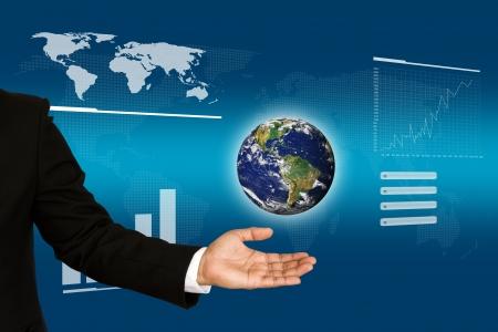 Earth on Businessman hand photo