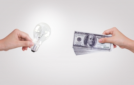 Hand with dollars and light bulb photo