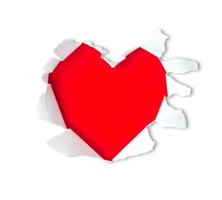 worn paper: Hoja de papel con un agujero de forma de coraz�n sobre fondo rojo brillante aislado en blanco