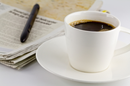 A cup of coffee and a newspaper photo