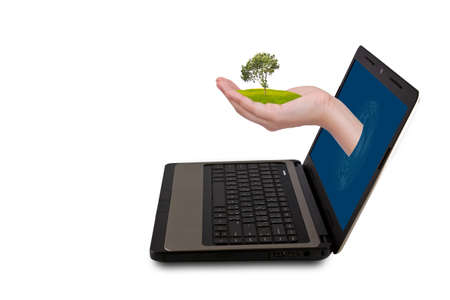 A Hand reaches out of an Laptop with a plant photo