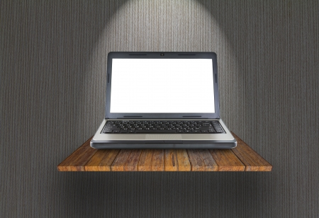 Laptop on wooden shelf photo