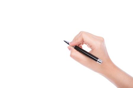 pad pen: Mano de la mujer con la pluma en un fondo blanco