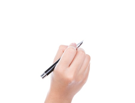Woman  hand with pen on a white background photo