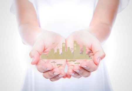Woman hands hold paper cut of city over body isolated on background. photo