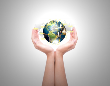 cradling: Two woman hands hold earth of social network (Elements of this image furnished by NASA) Stock Photo