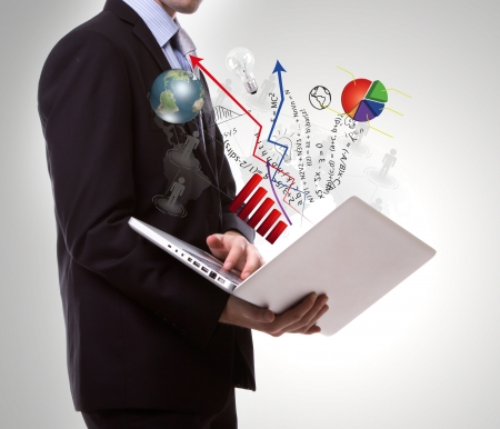 Business man with laptop Stock Photo - 15093444