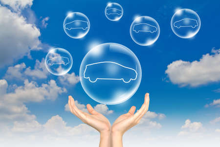 car inside: Hand hold Bubbles in the sky with car inside Stock Photo