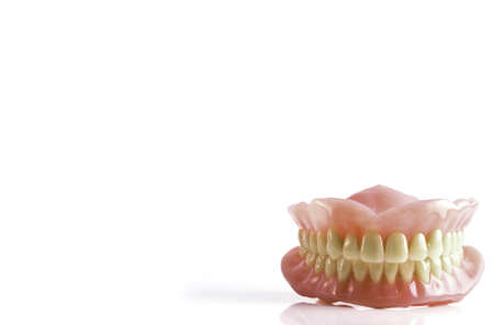 full set of acrylic denture isolated on white background photo