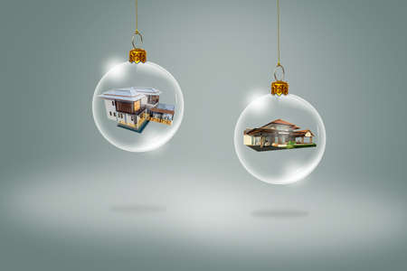 Transparent Christmas ball with house inside photo