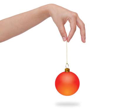 picking fingers: Human hand holding christmas ball