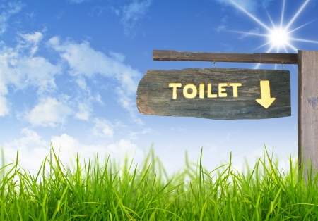 A wooden sign hung over the entrance to a toilet. Stock Photo - 15093542
