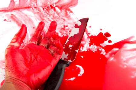 Halloween concept : Hand in blood with knife  on a white background photo