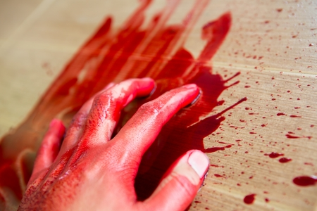 cut and blood: Halloween concept : Hand in blood Stock Photo