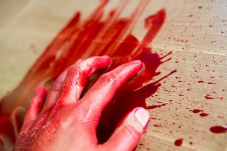 war crimes: Halloween concept : Hand in blood Stock Photo