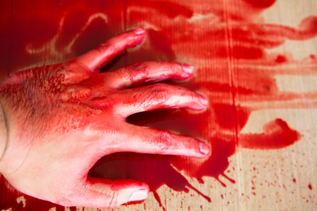 cut line: Halloween concept : Hand in blood Stock Photo