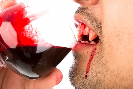 Halloween Vampire drink blood on white background photo