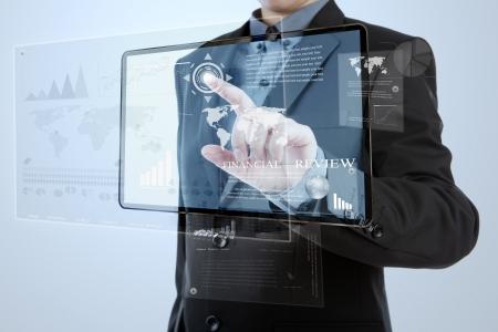 Businessman pushing a button on digital vurtual screen Stock Photo