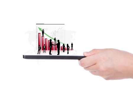 Hand holding the modern digital tablet pc with success growth chart photo