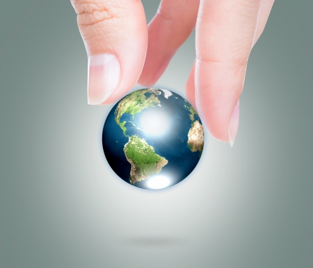 Hands with earth (Elements of this image furnished by NASA) photo