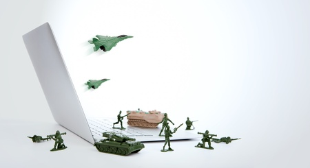 Computer security concept :  soldiers,tank,plane  are guarding a laptop from viruses, spyware and hacker Stock Photo - 15401351