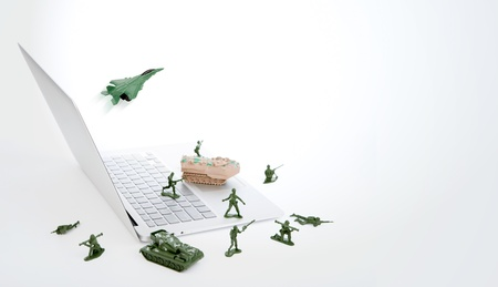 Computer security concept :  soldiers,tank,plane  are guarding a laptop from viruses, spyware and hacker Stock Photo - 15401350